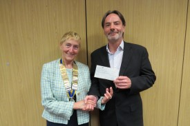 President Jackie presents a cheque to Aiden Knox of Warwick CAB