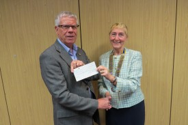 Jeff Reading receives a cheque on behalf of Cancer Research UK