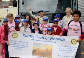 The Mayor of Warwick and the President of Warwick Rotary Club see the children off for their day out