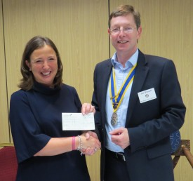 Rachel Ollerenshaw receives her cheque from Jon Wassall