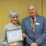 Joan is pictured with Rotary President, John Taylor