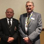 Om Gurung with Rotary President John Taylor.