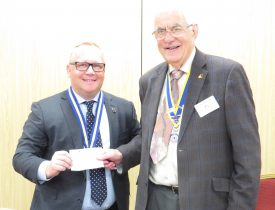 Michael Vallance receives a cheque from club President, John Hibben